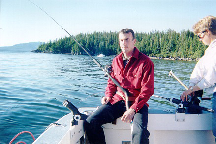 Picture of the StrikeFighter™ showing the sitting fishing position while fishing out back of boat.