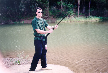 Picture of StrikeFighter with a trout rod.